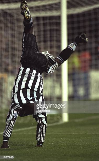 Faustino Asprilla of Newcastle celebrates with a cartwheel during the Champions League match against Barcelona at St James'' Park in Newcastle...