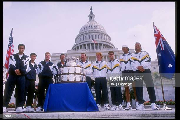 Members of the USA and Australia teams stand in front of the Davis Cup at the US Capitol during the David Cup Semi Draw at the US Capitol in...