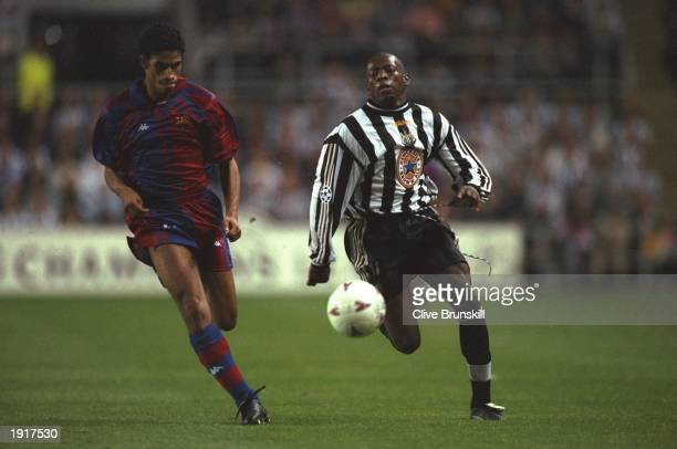 Michael Reiziger of Barcelona takes on Faustino Asprilla of Newcastle United during the Champions League match at St James'' Park in...