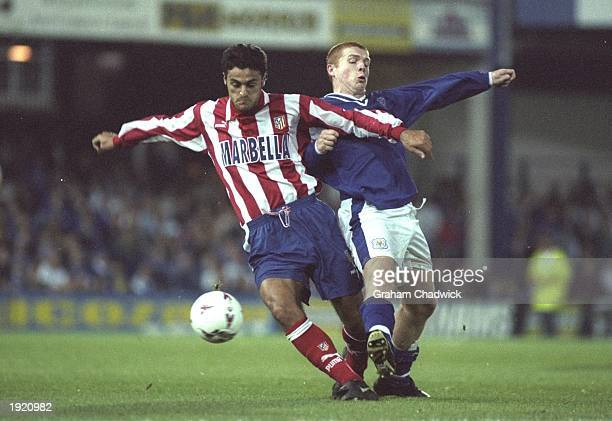 Neil Lennon of Leicester City is jostled off the ball by an Atletico Madrid player during the UEFA Cup match at Filbert Street in Leicester England...
