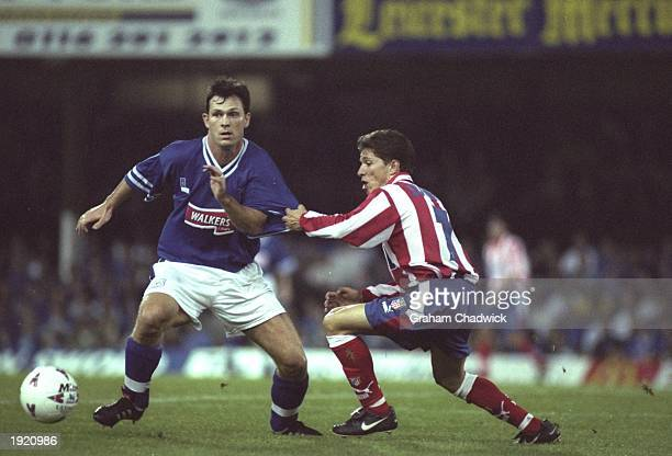 Pontus Kaamark of Leicester City takes on Juninho of Atletico Madrid during the UEFA Cup match at Filbert Street in Leicester England Atletico Madrid...