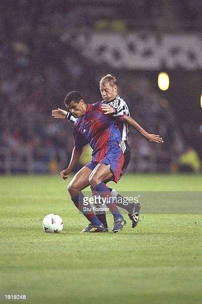 Rivaldo of Barcelona holds off the challenge of David Batty of Newcastle United during the Champions League match at St James Park in Newcastle...