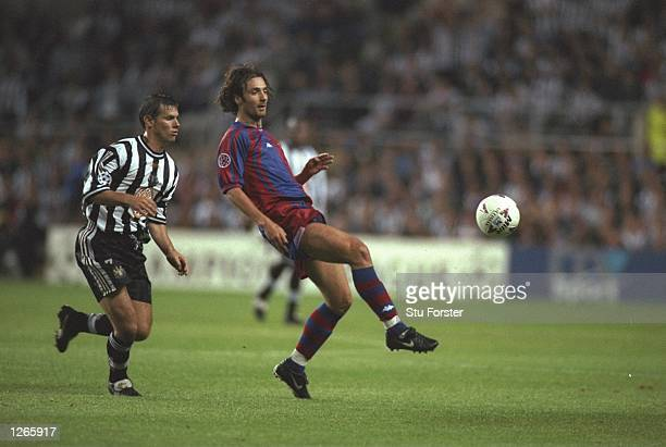 Robert Lee of Newcastle United and Christophe Dugarry of Barcelona in action during a UEFA Champions League match at St James'' Park in Newcastle...