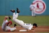 Runner Scott Rolen of the Philadelphia Phillies takes out infielder Craig Counsell of the Florida Marlins during a double play during the Phillies 82...