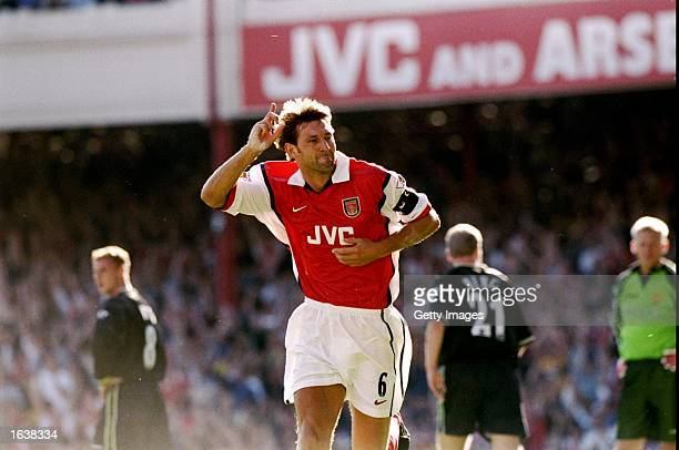 Arsenal captain Tony Adams celebrates his goal during the FA Carling Premiership match against Manchester United at Highbury in London Arsenal won 30...