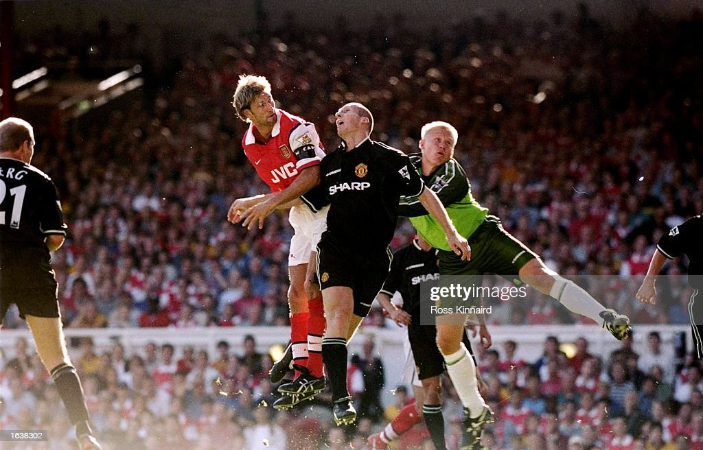 Tony Adams, Jaap Stam and Peter Schmeichel : News Photo