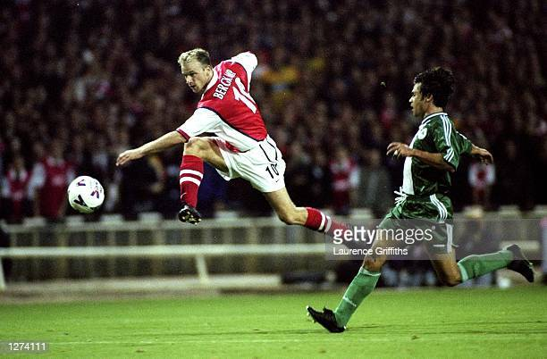 Dennis Bergkamp of Arsenal lets fly during the UEFA Champions League match against Panathinaikos at Wembley in London Arsenal won 21 Mandatory Credit...