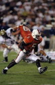 Edgerrin James of the Miami Hurricanes runs with the ball during a game against the East Tennessee State Buccaneers at the Orange Bowl in Miami...
