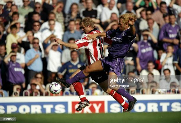 Egil Ostenstad of Southampton takes on Paolo Tramezzani of Tottenham Hotspur during the FA Carling Premiership match at the Dell in Southampton...