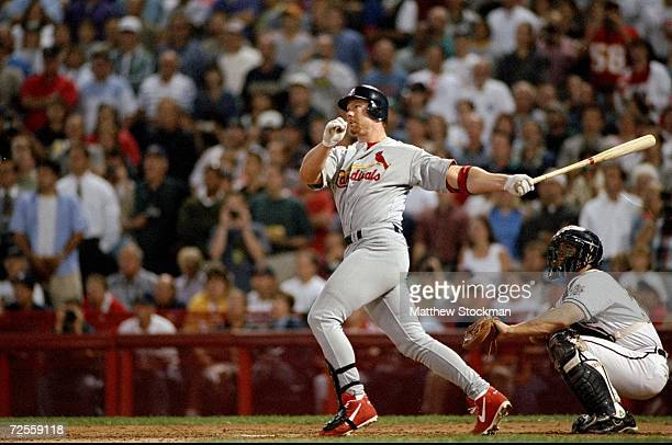First baseman Mark McGwire of the St Louis Cardinals hits his 64th home run of the season during a game against the Milwaukee Brewers at the County...