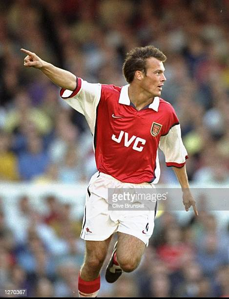 Fredrik Ljungberg of Arsenal celebrates a goal on his debut during the FA Carling Premiership match against Manchester United at Highbury in London...