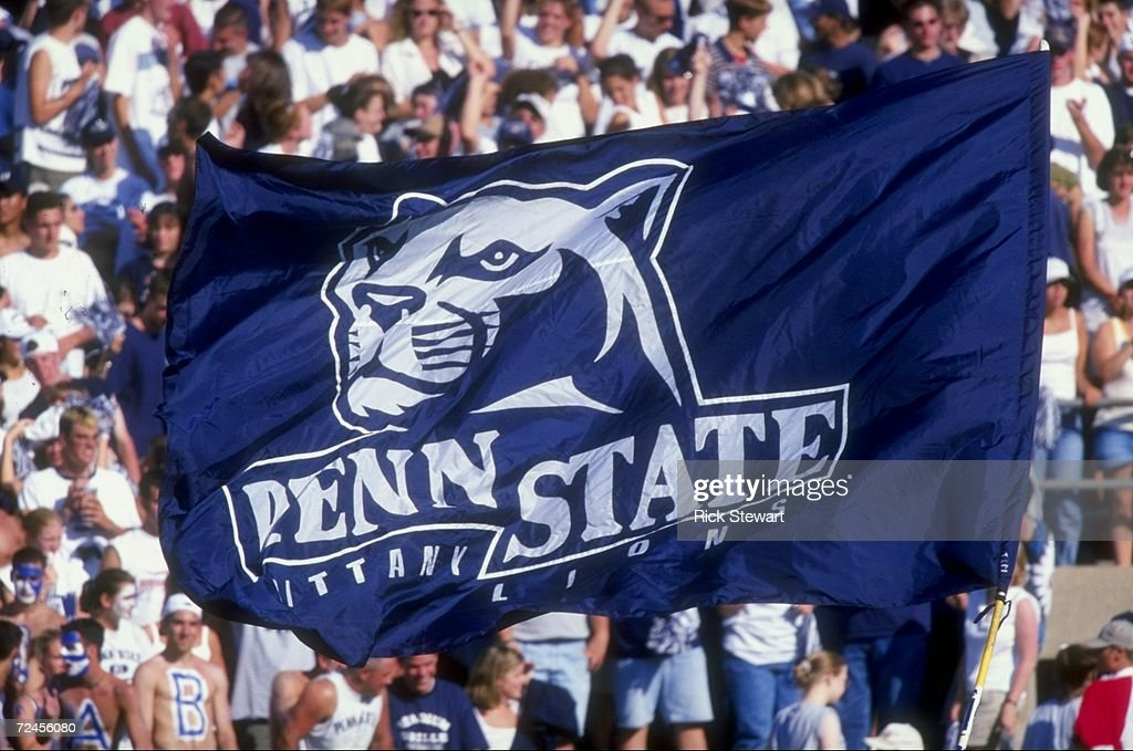 Penn State Nittany Lion fans hoist a flag up in the air during a game against the Southern Mississippi State Golden Eagles at the Beaver Stadium in State College, Pennsylvania. The Nittany Lions defeated the Golden Eagles 34-6. Mandatory Cred