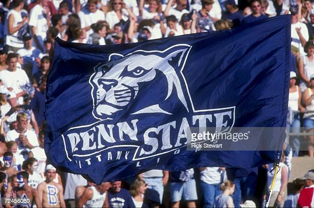 Penn State Nittany Lion fans hoist a flag up in the air during a game against the Southern Mississippi State Golden Eagles at the Beaver Stadium in...