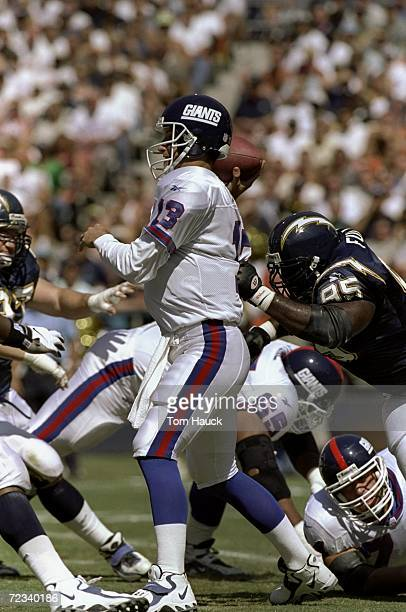 Quarterback Danny Kanell of the New York Giants in action against defensive end William Fuller of the San Diego Chargers during the game at the...