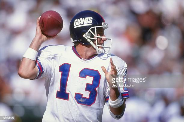 Quarterback Danny Kanell of the New York Giants looks to throw the ball during the game against the Oakland Raiders at the Oakland Coliseum in...