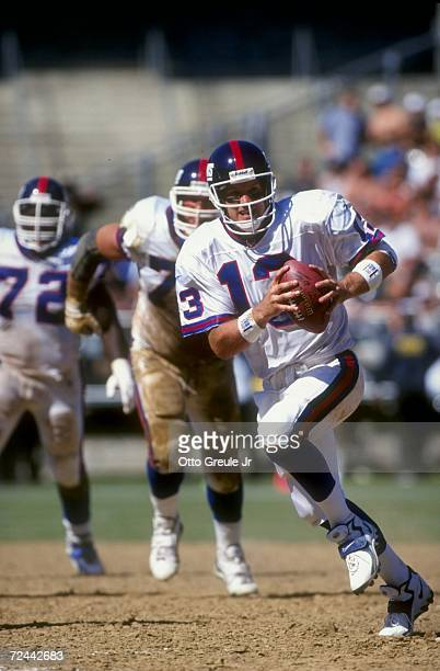 Quarterback Danny Kanell of the New York Giants running with the ball during the game against the Oakland Raiders at the Oakland Coliseum in Oakland...