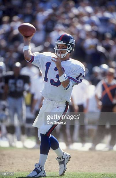Quarterback Danny Kanell of the New York Giants throwing the ball during the game against the Oakland Raiders at the Oakland Coliseum in Oakland...