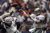 Quarterback Jason Garrett of the Dallas Cowboys throws a pass during a game against the Oakland Raiders at the Texas Stadium in Dallas Texas The...