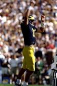 Quarterback Tom Brady of the Michigan Wolverines in action during the game against the Eastern Michigan Eagles at the Michigan Stadium in Ann Arbor...