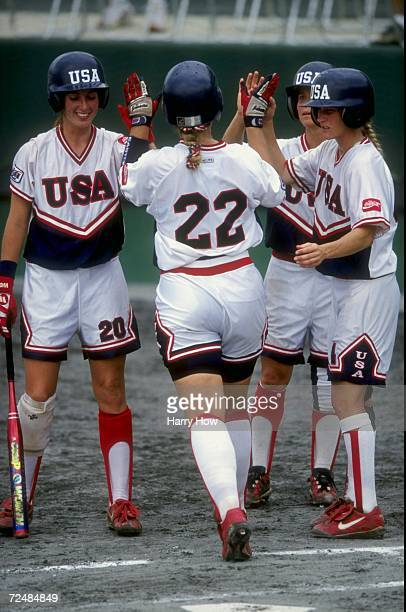 Sheila Douty of Team USA is met after crossing home plate by teammates Leah O''Brien and Laura Berg during the ISF Women''s World Championships game...