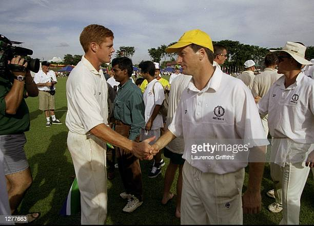 The two captains Shaun Pollock of South Africa and Steve Waugh of Australia shake hands after the cricket final during the Commonwealth Games in...