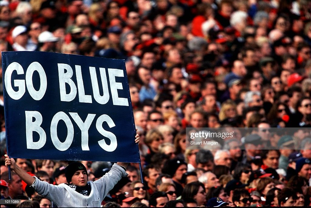 A Carlton fan holds a banner high encouraging his team in the match between Carlton and Essendon in the 2nd Preliminary final at the Melbourne Cricket Ground, Melbourne, Australia. Carlton advanced to the Australian Football League GrandFinal next week. Mandatory Credit: Stuart Milligan/ALLSPORT
