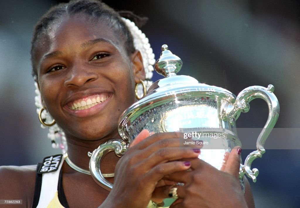 A close up of Serena Williams of the USA as she poses with her trophy after the match between Martina Hingis of Switzerland in the US Open at the...