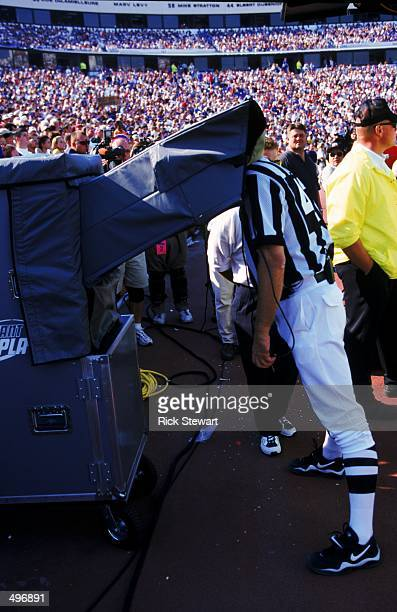 A referee watches the instant replay during a game between the Philadelphia Eagles and the Buffalo Bills at the Ralph Wilson Stadium in Orchard Park...
