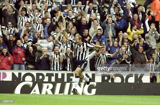 Alan Shearer of Newcastle salutes a goal during the Newcastle United v Sheffield Wednesday FA Carling Premier League match played at St James's Park...