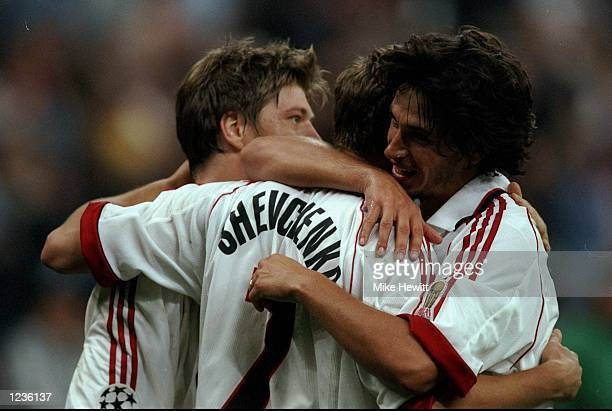Andriy Shevchenko of AC Milan celebrates his goal against Galatasaray with team mates Thomas Helverg and Demetrio Albertini during the Champions...