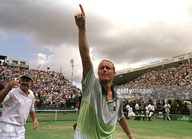 Australia captain John Newcombe on left and Lleyton Hewitt of Australia celebrate after Hewitt won 64 75 62 over Yevgeny Kafelnikov of Russia during...