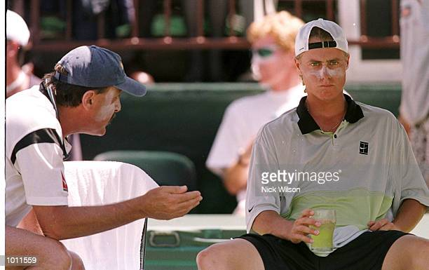 Australia Davis Cup Captain John Newcombe on left advises Lleyton Hewitt of Australia during his singles match against Marat Safin of Russia during...