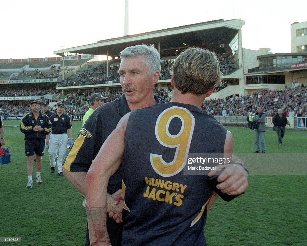 Ben Cousins #9 for the West Coast Eagles bids farewell to coach Mick Malthouse after losing to Carlton, the first semi final played at the MCG, Melbourne, Victoria, Australia. Carlton eliminated West Coast from the finals series, and Malthouse is returning to Victoria. Mandatory Credit: Mark Dadswell/ALLSPORT