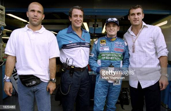 Benetton driver Giancarlo Fisichella of Italy with team owner Rocco Benetton and Inter Milan footballers Chistian Vieri and Luigi Di Biagio during...