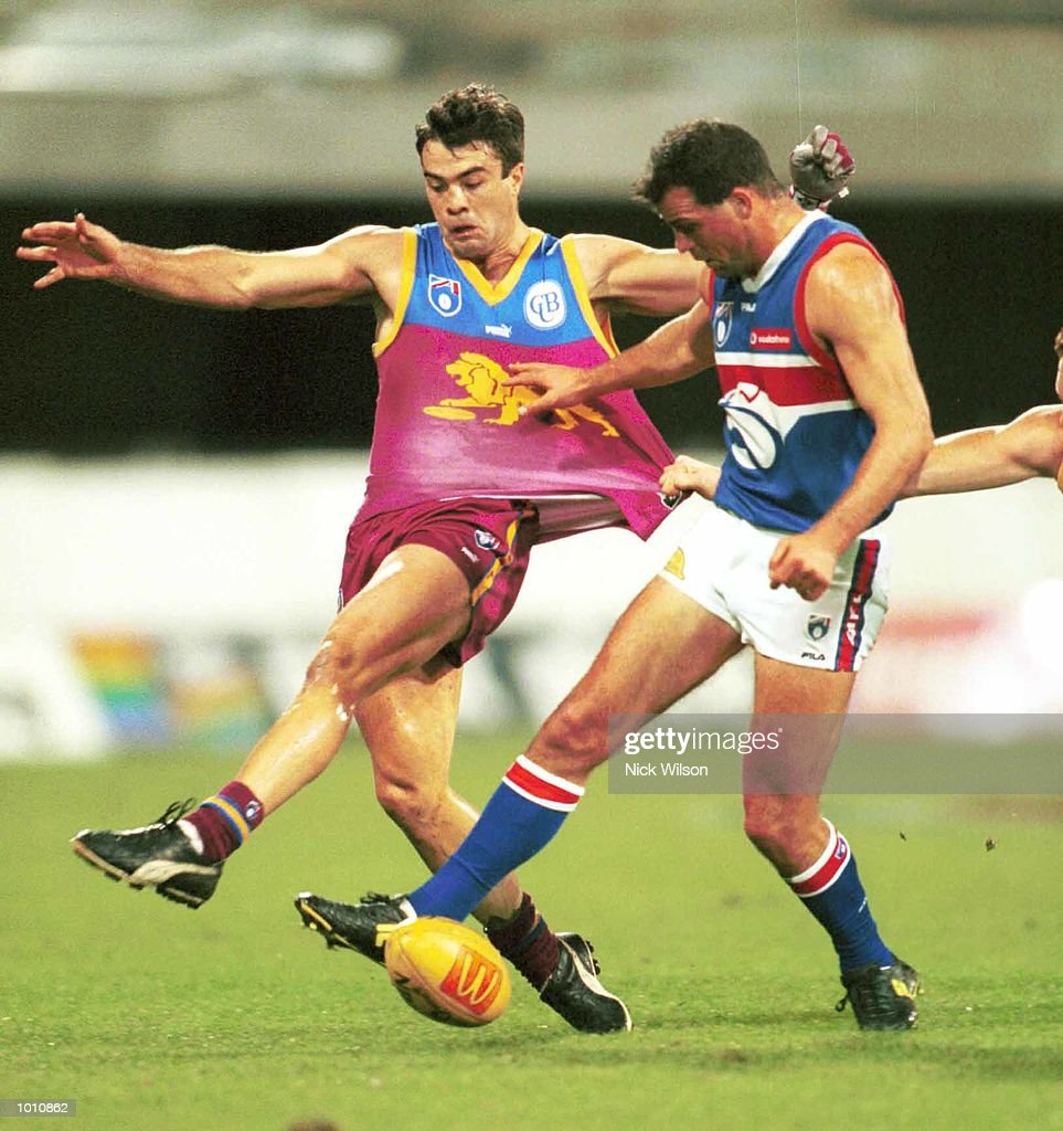 Brad Johnson #6 for the Western Bulldogs and Chris Scott #22 for the Brisbane Lions compete for the ball during the 2nd semi final between the Brisbane Lions and the Western Bulldogs at the Gabba, Brisbane, Australia. Mandatory Credit: Nick Wilson/ALLSPORT