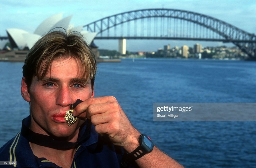 Brownlow medal winner Shane Crawford of Hawthorn kisses his Brownlow medal with the Harbour Bridge and Opera House in the background. Sydney,Australia. Mandatory Credit: Stuart Milligan/ALLSPORT