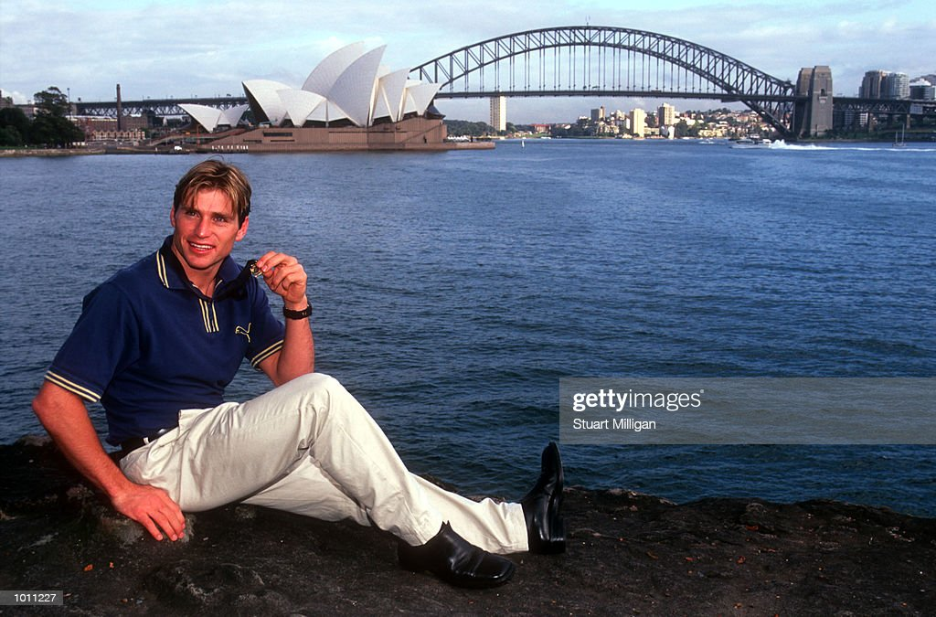 Brownlow medal winner Shane Crawford of Hawthorn show of his Brownlow medal with the Harbour Bridge and Opera House in the background. Sydney,Australia. Mandatory Credit: Stuart Milligan/ALLSPORT