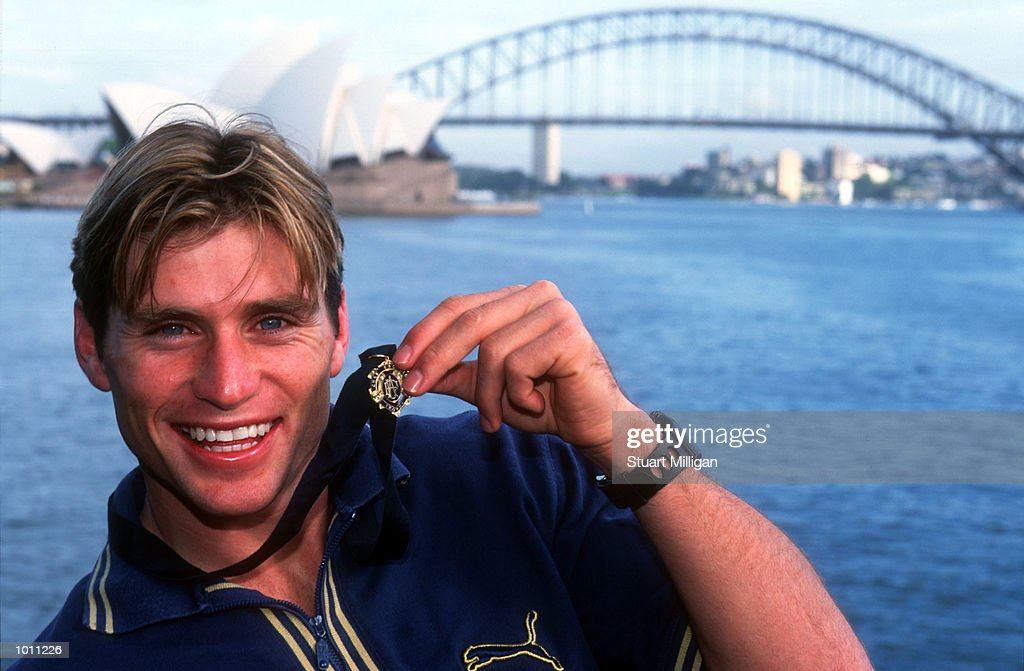 Brownlow medal winner Shane Crawford of Hawthorn shows of his Brownlow medal with the Harbour Bridge and Opera House in the background. Sydney,Australia. Mandatory Credit: Stuart Milligan/ALLSPORT