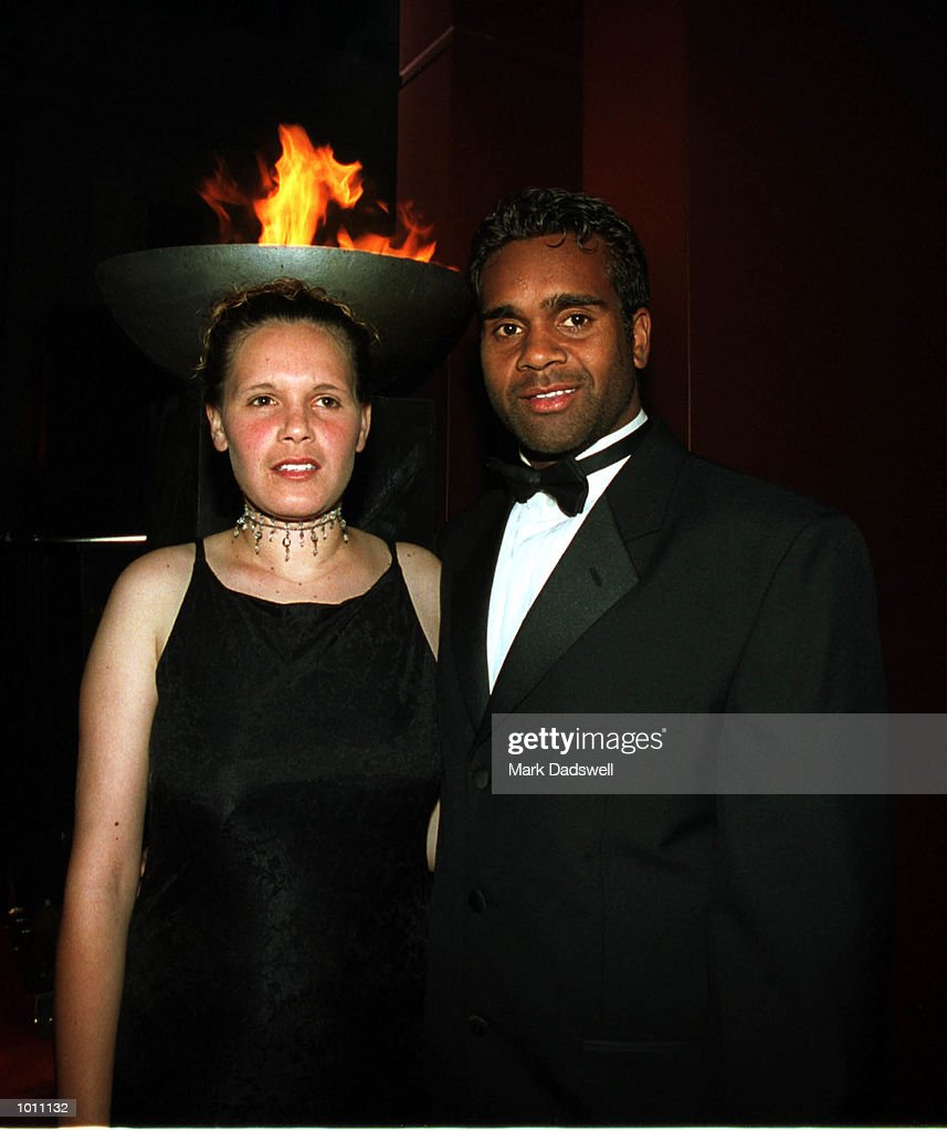 Byron Pickett of the Kangarros football club with partner Rebecca Saunders pose for photographs during the Brownlow medal presentation night at the Horden Pavilion function centre,Moore Park Sydney Australia. Mandatory Credit: Mark Dadswell/ALLSPORT