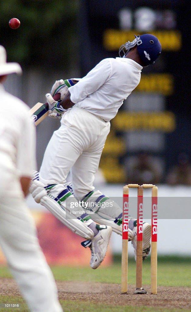 Chaminda Vaas of Sri Lanka rears away from a bouncer off the bowling of Glenn McGrath, during day one of the second test between Sri Lanka and Australia at Galle International Stadium, Galle, Sri Lanka.X Mandatory Credit: Hamish Blair/ALLSPORT
