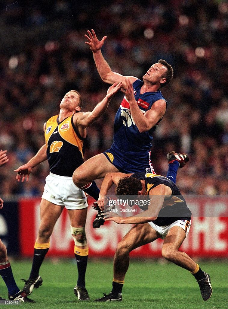 Chris Grant #3 for the Western Bulldogs flies over Daniel Metropolis #8 and Guy McKenna #17 for the West Coast Eagles, during the fist Qualifying Final played between the Western Bulldogs and the West Coast Eagles played at the M.C.G, Melbourne, Australia. West Coast won the match by five points. Mandatory Credit: Mark Dadswell/ALLSPORT