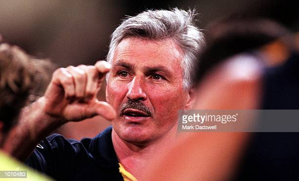 Coach of the West Coast Eagles Mick Malthouse addresses his players at the quarter time break during the fist Qualifying Final played between the...
