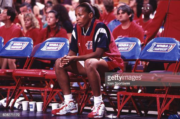 Cynthia Cooper of the Houston Comets sits on the bench prior to the Comets 5947 victory over the New York Liberty in the WNBA Championship Game at...