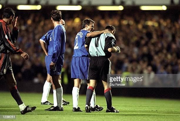 Dan Petrescu of Chelsea consoles Claudio Taffarel of Galatasaray after the goalkeeper was shown the red card during the Chelsea v Galatasaray UEFA...
