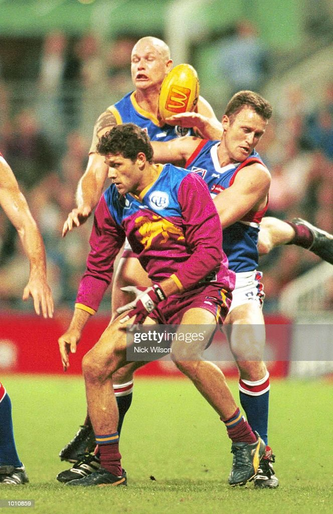 Darryl White #33 & Matthew Kennedy #41 for the Brisbane Lions, and Chris Grant #3 for the Western Bulldogs contest the mark during the 2nd semi final between the Brisbane Lions and the Western Bulldogs at the Gabba, Brisbane, Australia. Mandatory Credit: Nick Wilson/ALLSPORT