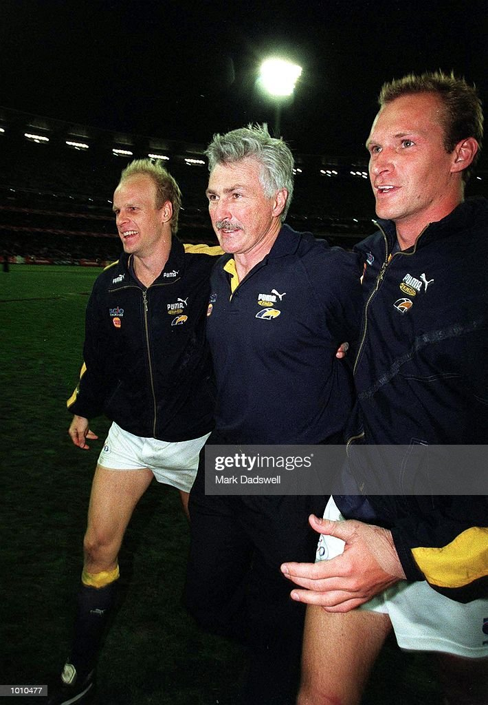 Dean Kemp #2 and Nicholas Stone #22 for the West Coast Eagles congratulate coach Mick Malthouse after the fist Qualifying Final played between the Western Bulldogs and the West Coast Eagles played at the M.C.G, Melbourne, Australia. West Coast won the match by five points. Mandatory Credit: Mark Dadswell/ALLSPORT