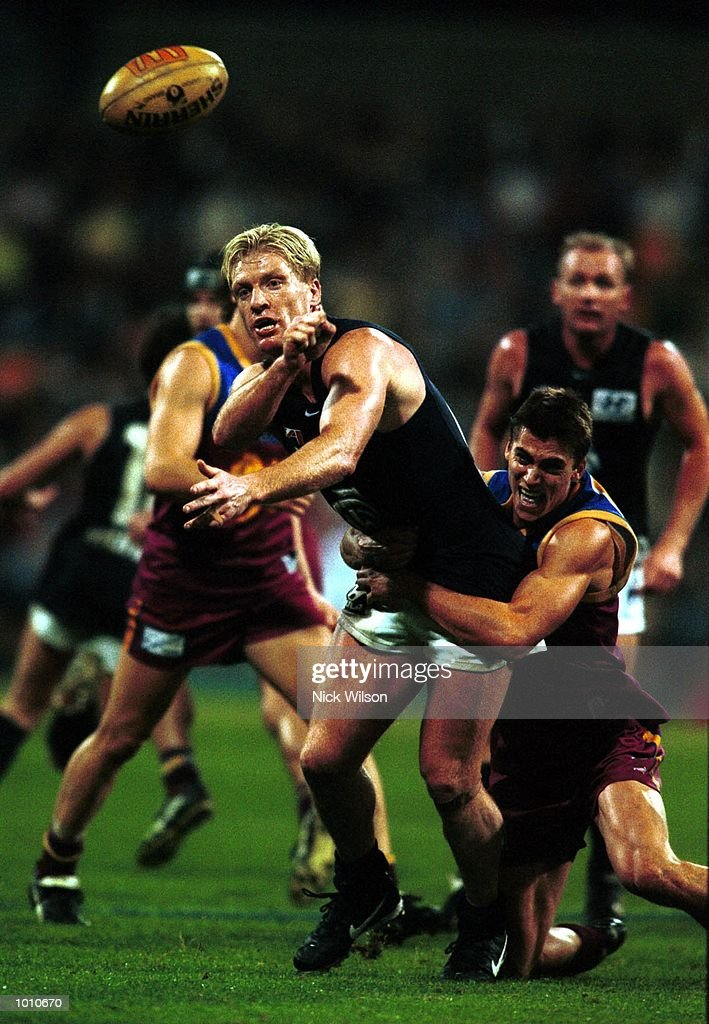 Dean Rice of Carlton is tackled by Marcus Ashcroft of Brisbane Lions during the second AFL qualifying final between the Brisbane Lions and Carlton at The Gabba, Brisbane, Australia. Brisbane won the game 20.18.138 to 8.17.65. Mandatory Credit: Nick Wilson/ALLSPORT