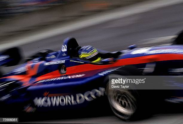 Driver Cristiano da Matta of Brazil drives the Toyota Reynard 99I for MCI/ArcieroWells Racing speeds on the wet track during the Molson Indy...