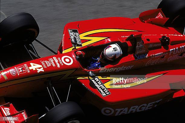Driver Juan Pablo Montoya of Columbia drives the Honda Reynard 99I for Target/Chip Ganassi sits in his car during the Molson Indy Vancouver part of...