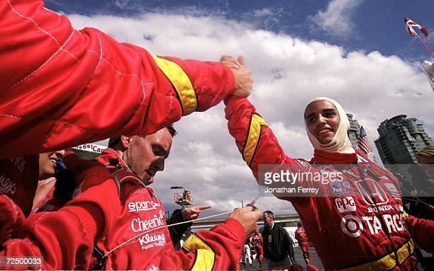 Driver Juan Pablo Montoya of Columbia who drivers the Honda Reynard 99I for Target/Chip Ganassi is celebrating after winning the Molson Indy...
